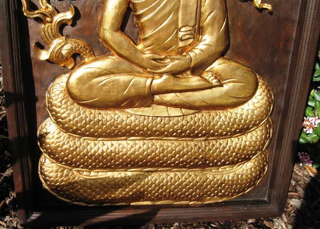 Hand carved gold leaf buddha on naga