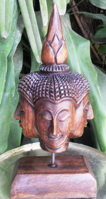 Four Face Buddha Head on stand