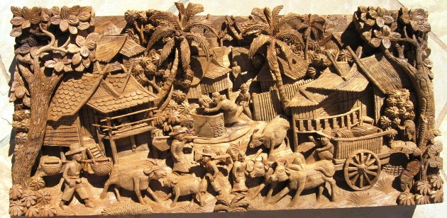 Hand carved thai village scene teak panel