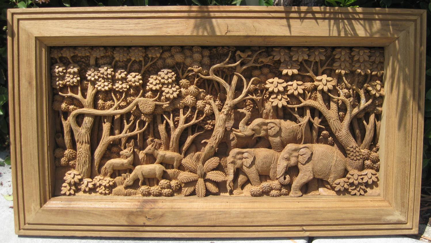 Hand carved elephants scene teak panel